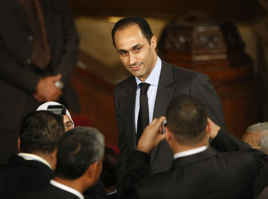 In this Thursday, June 4, 2009, file photo, Gamal Mubarak, center, son of Egyptian President Hosni Mubarak, talks to guests prior to the speech of President Obama at Cairo University. (AP Photo/Ben Curtis, File)