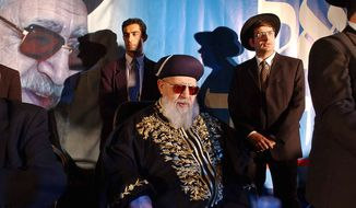 "**FILE** In this photo from Dec. 5, 2002, Rabbi Ovadia Yosef (center) sits surrounded by members of his staff during a rally of his Ultra-Orthodox Shas party in Jerusalem. Yosef, an influential Israeli rabbi known for his vitriolic pronouncements against Arabs, said Palestinians and their leader should ""perish from this world"", Israeli army Radio said Sunday. (Associated Press)"