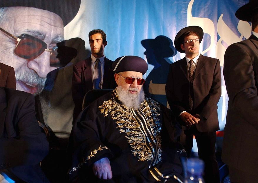 """**FILE** In this photo from Dec. 5, 2002, Rabbi Ovadia Yosef (center) sits surrounded by members of his staff during a rally of his Ultra-Orthodox Shas party in Jerusalem. Yosef, an influential Israeli rabbi known for his vitriolic pronouncements against Arabs, said Palestinians and their leader should """"perish from this world"""", Israeli army Radio said Sunday. (Associated Press)"""