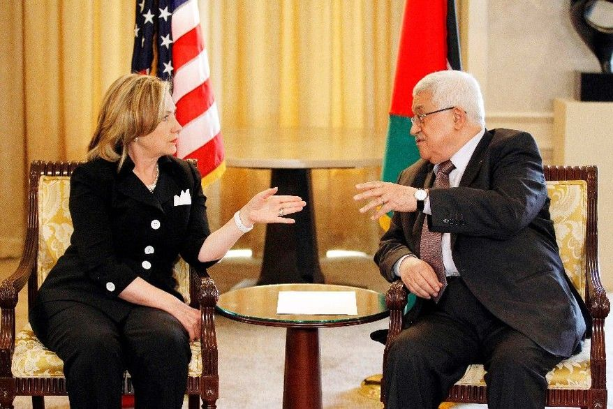 Secretary of State Hillary Rodham Clinton meets with Palestinian President Mahmoud Abbas Tuesday in Arlington, Va., as the U.S. prepares to relaunch Middle East peace talks at the White House. (Associated Press)