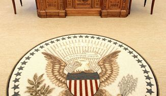 "A guest's view of the Oval Office shows the Great Seal of the United States in the middle of a new rug that is bordered with five sayings ""of meaning to the president."" The famous Resolute Desk remains after renovations."