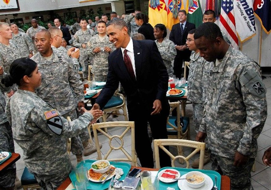 """ASSOCIATED PRESS 'TURN THE PAGE': President Obama greets members of the military at Fort Bliss in El Paso, Texas, on Tuesday. """"Operation Iraqi Freedom is over,"""" he said in his Oval Office address to the nation."""