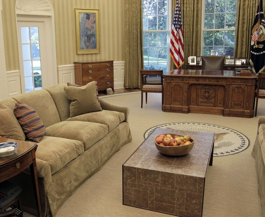 Renovations to the Oval Office, including a new carpet, drapes, wallpaper and furniture, are pictured on Tuesday, Aug. 31, 2010, at the White House in Washington. (AP Photo/J. Scott Applewhite)