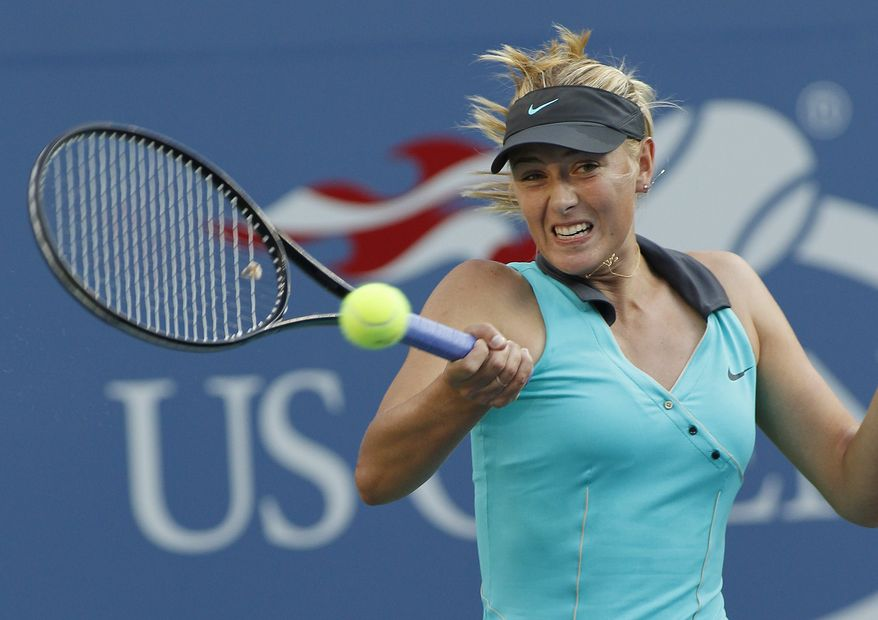 ASSOCIATED PRESS Maria Sharapova of Russia returns the ball to Jarmila Groth of Australia during the first round of the U.S. Open tennis tournament in New York, Tuesday, Aug. 31, 2010.