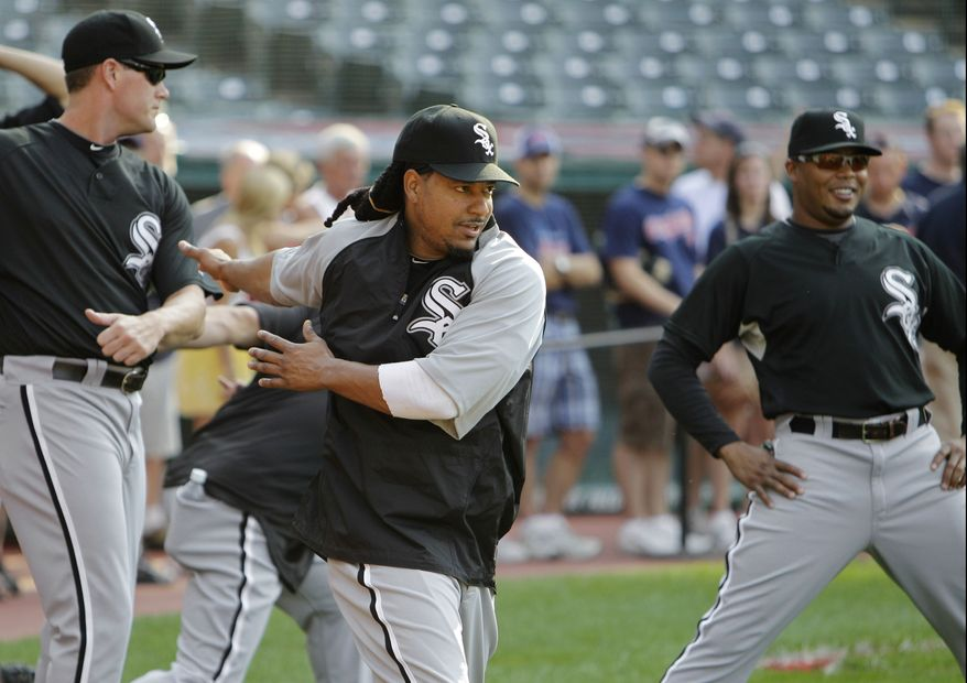 ASSOCIATED PRESS Chicago White Sox's Manny Ramirez, center, warms up with his new teammates before a baseball game against the Cleveland Indians, Tuesday, Aug. 31, 2010, in Cleveland.