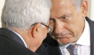 Israeli Prime Minister Benjamin Netanyahu (right) engages Palestinian President Mahmoud Abbas after his remarks on the Middle East peace negotiations Wednesday in the East Room of the White House. (Associated Press)