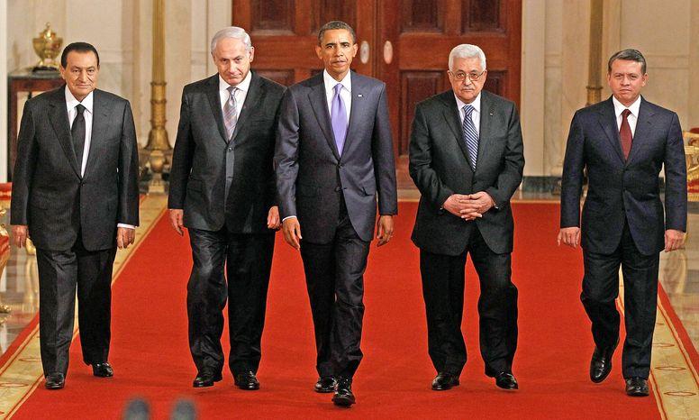 NEGOTIATORS: President Obama walks with Mideast leaders, from left, Hosni Mubarak, Benjamin Netanyahu, Mahmoud Abbas and King Abdullah II to the East Room to make a statement about peace talks. (Associated Press)