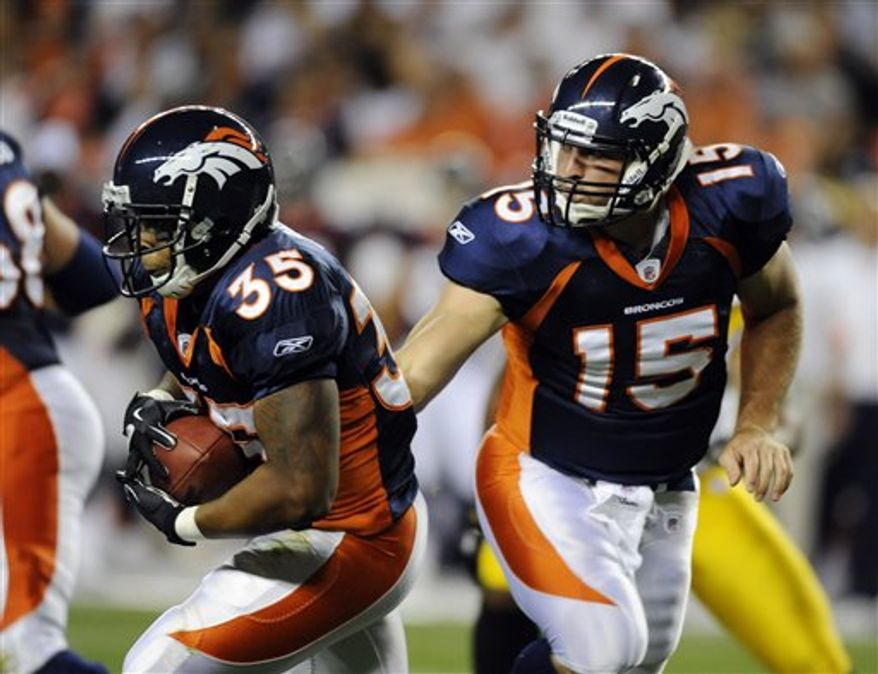 Denver Broncos quarterback Tim Tebow (15) hands the ball off to Lance Ball (35) during the second half of a preseason NFL football game against the Pittsburgh Steelers on Sunday, Aug. 29, 2010, in Denver. (AP Photo/Chris Schneider)