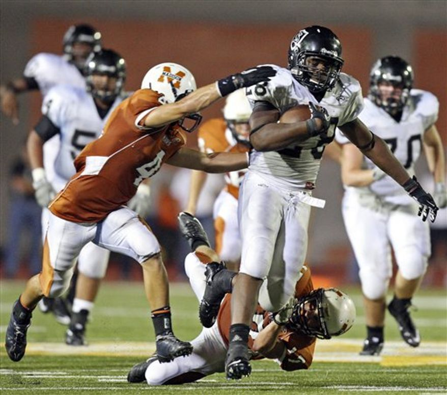 In this July 23, 2009, photo, Steele High School running back Malcolm Brown poses for a photo in San Antonio. (AP Photo/San Antonio Express-News, Edward A. Ornelas)