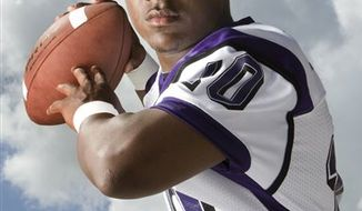 In this Aug. 19, 2009, photo, Angleton High School quarterback Quandre Diggs poses for a portrait in Angleton, Texas. (AP Photo/Houston Chronicle, Brett Coomer)