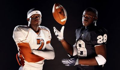 In this July 23, 2009, photo, James Madison High School running back Aaron Green, left, and Steele High School running back Malcolm Brown pose for photos in San Antonio. (AP Photo/San Antonio Express-News, Edward A. Ornelas)