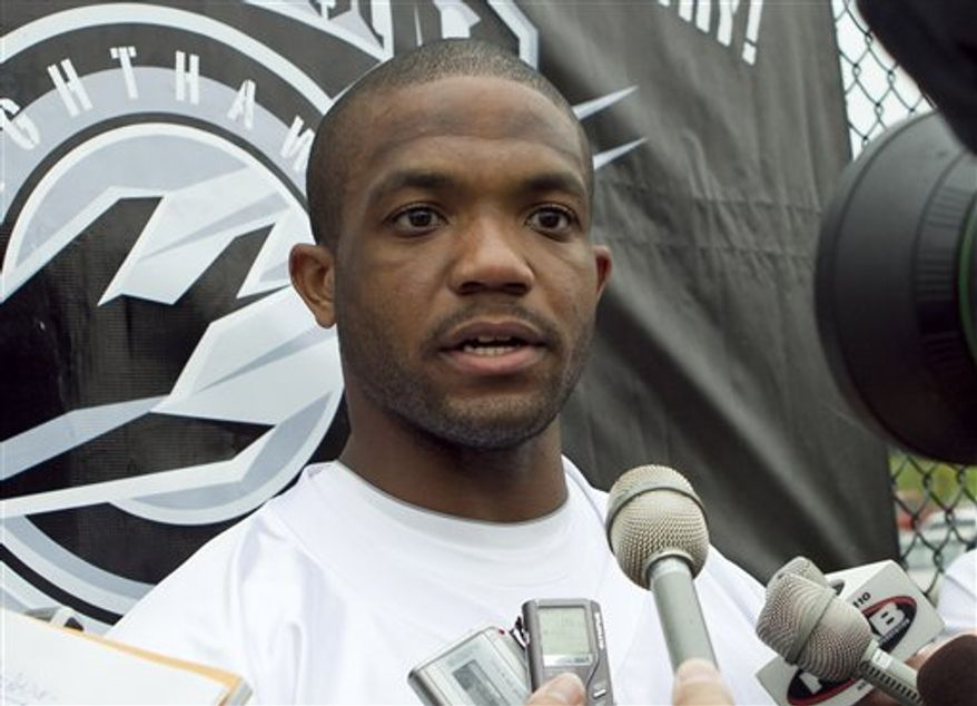 "FILE - This Sept. 1, 2010, file photo shows Maurice Clarett speaking to reporters following team practice with the United Football League's Omaha Nighthawks,  in Omaha, Neb. Clarett says he would spend another year with the UFL's Omaha Nighthawks if they want him back. He told The Associated Press that the Nighthawks' opportunity has been ""a blessing from God."" (AP Photo/Nati Harnik, File)"