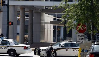 Police block the street in front of the headquarters of the Discovery Channel networks building in Silver Spring, Md., Wednesday Sept. 1, 2010. Police say a gunman has taken at least one person hostage in the building. (AP Photo/Jose Luis Magana)