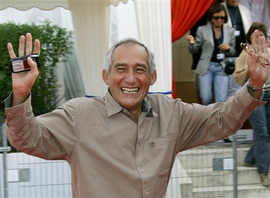FILE - In this Sept. 5, 2005 file photo, French Director Alain Corneau waves to photographers upon his arrival at a screening, in Deauville, Normandy, France, Monday, Sept. 5, 2005. Corneau, 67, died Sunday, Aug. 29, 2010 in Paris, his agency Artemedia said. (AP Photo/Francois Mori, File)