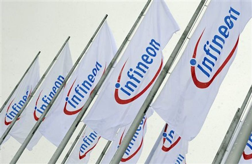 FILE - In this Feb. 12, 2009 file photo, flags with the company logo of Infineon Technologies are seen prior to the annual shareholders meeting in Munich, southern Germany. German chipmaker Infineon Technologies AG is selling a unit that makes products for wireless telephones to California's Intel Corp. in a $1.4 billion cash deal, the companies said Monday, Aug. 30, 2010. (AP Photo/Uwe Lein, File)