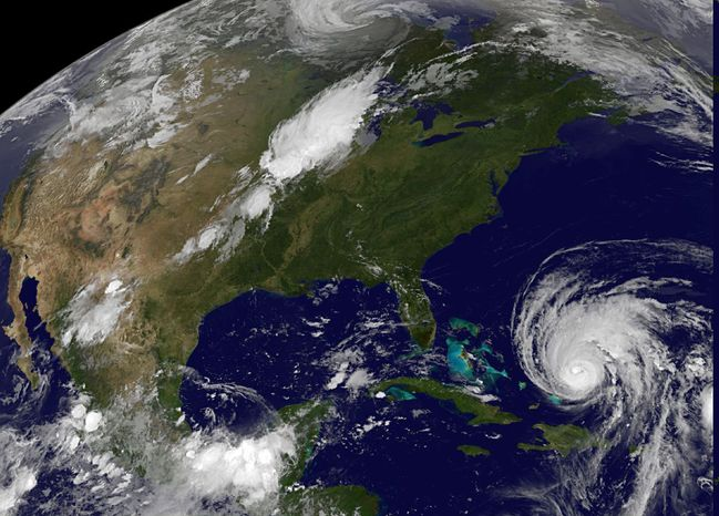 This image provided by the National Aeronautics and Space Administration shows Hurricane Earl (lower right) at 1 a.m. EDT on Wednesday, Sept. 1, 2010. At 11 p.m. EDT Tuesday the center of the storm was located about 910 miles south-southeast of Wilmington, N.C. The Category 4 hurricane was moving northwest at 15 mph with maximum sustained winds of 135 mph. (AP Photo/NASA)