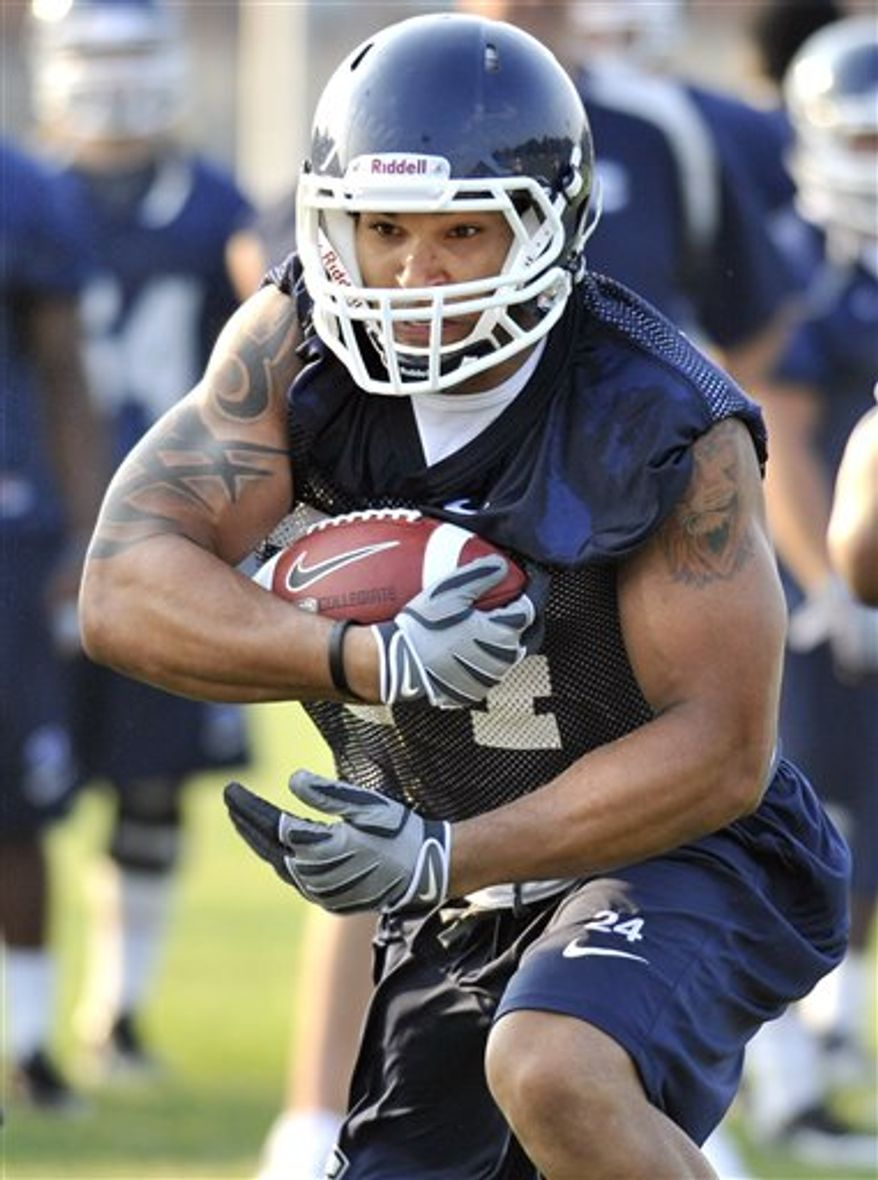FILE - In this Aug. 9, 2010, file photo, Connectcut's D.J. Shoemate runs with the ball during NCAA college football practice at Storrs, Conn.  Shoemate wasn't thinking about transferring from Southern California last season, when he traveled with a friend's family to watch Connecticut beat Notre Dame in South Bend. But after NCAA sanctions gave him the opportunity to leave USC without penalty, his impressions from that day helped him decide to change coasts. (AP Photo/Jessica Hill, File)