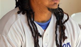 Chicago White Sox's Manny Ramirez, right, talks with new teammate, catcher A.J. Pierzynski, before a baseball game against the Cleveland Indians, Tuesday, Aug. 31, 2010, in Cleveland. (AP Photo/Mark Duncan)