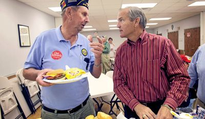 "ASSOCIATED PRESS Rep. Chet Edwards (right) listens to Army veteran Dan Poluda at the VFW post in West, Texas, on Wednesday. ""I'm used to being a target,"" Mr. Edwards said. ""This year there's clearly an anti-Washington environment, and I share those frustrations."""