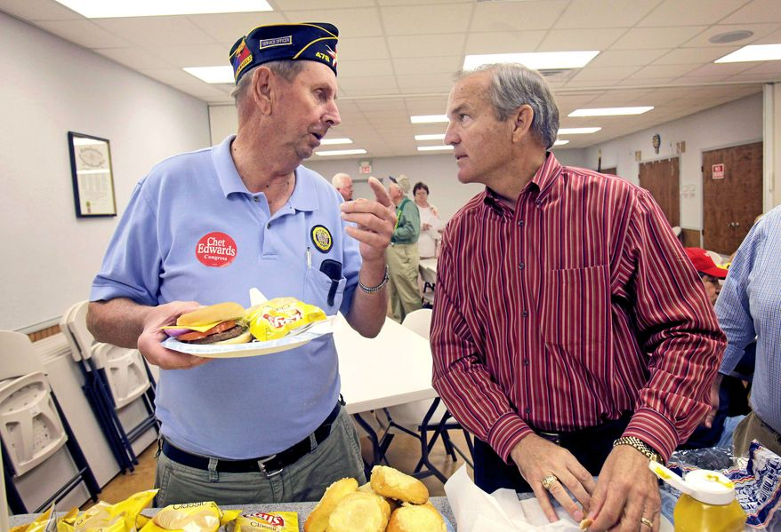 """ASSOCIATED PRESS Rep. Chet Edwards (right) listens to Army veteran Dan Poluda at the VFW post in West, Texas, on Wednesday. """"I'm used to being a target,"""" Mr. Edwards said. """"This year there's clearly an anti-Washington environment, and I share those frustrations."""""""