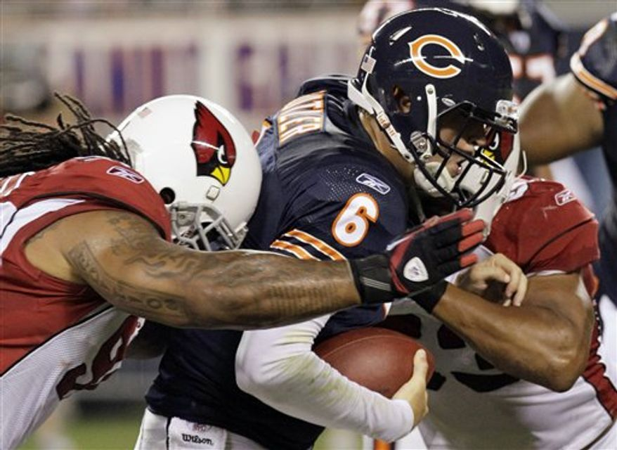 Chicago Bears quarterback Jay Cutler (6) gets sacked by Arizona Cardinals defensive tackle Darnell Dockett, left, and linebacker Clark Haggans, right, during the first half of an NFL preseason football game Saturday, Aug. 28, 2010, in Chicago. (AP Photo/Charles Rex Arbogast)
