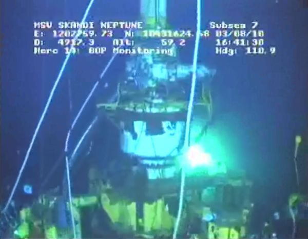 """** FILE ** A 75-ton cap sits atop the Deepwater Horizon oil well in the Gulf of Mexico on Tuesday, Aug. 3, 2010, in this image taken from video provided by BP PLC. The cap will be removed Thursday or Friday as part of the preparations to complete the """"bottom kill"""" procedure to seal the well permanently. (AP Photo/BP PLC)"""
