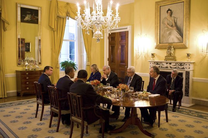 In this image released by the White House, President Obama, second left, holds a working dinner with, clockwise from left, Jordan's King Abdullah II, Secretary of State Hillary Rodham Clinton, Israeli Prime Minister Benjamin Netanyahu, Palestinian Authority President Mahmoud Abbas, Quartet Representative Tony Blair, Special Envoy for Mideast peace George Mitchell, and Egyptian President Hosni Mubarak, in the Old Family Dining Room of the White House, Wednesday, Sept. 1, 2010, in Washington. (AP Photo/The White House, Pete Souza)
