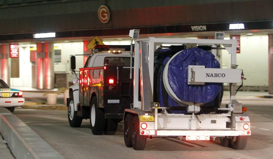 A Miami-Dade bomb squad truck leaves Miami International Airport in Miami, Friday, Sept. 3, 2010. (AP Photo/Alan Diaz) ** FILE **