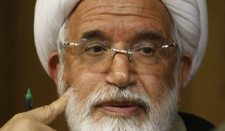 In this June 9, 2009, file photo, Iranian opposition leader Mahdi Karroubi attends a press conference in Tehran. Pro-government militiamen attacked Mr. Karroubi's home with homemade bombs and beat one of his bodyguards unconscious Thursday, Sept. 2, 2010, an opposition website reported, in an apparent attempt to keep him from attending the annual state-sponsored rally known as Quds Day, or Jerusalem Day. (AP Photo/Vahid Salemi, File)