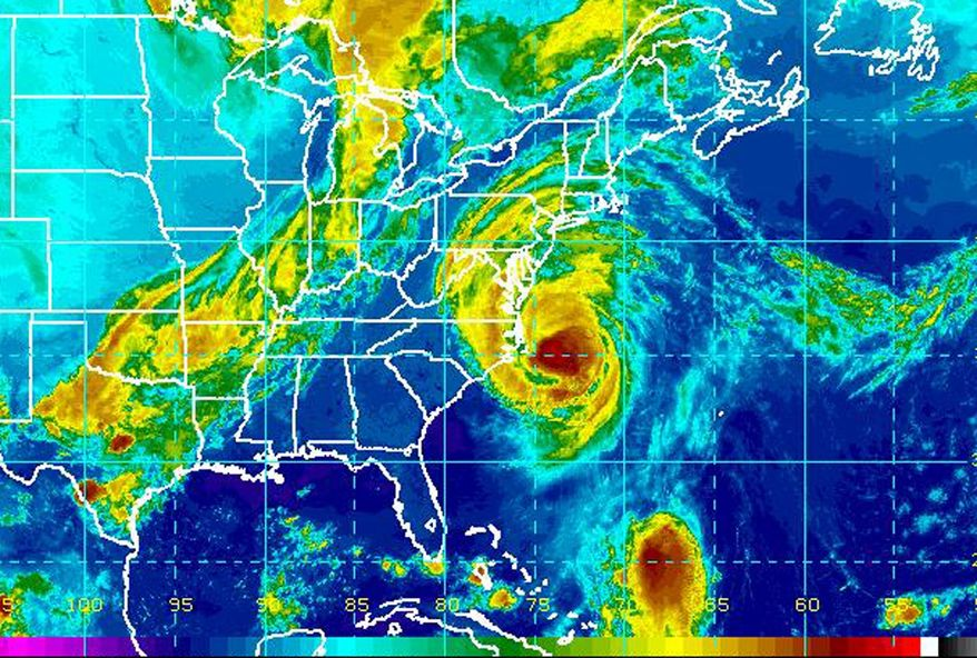 This satellite image provided by NOAA shows Hurricane Earl taken at 3:15 a.m. EDT on Friday, Sept. 3, 2010. National Weather Service meterologist Jeremy Schulz said early Friday morning that rain bands stretched about 140 miles inland in North Carolina and up to the southern tip of the Chesapeake Bay in Virginia. Sustained winds of about 30 mph were whipping the North Carolina coast. (AP Photo/NOAA)