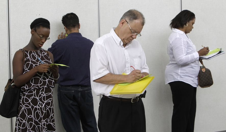 In this Aug. 25, 2010, photograph, job seekers including Pat Mosher, third from left, fill out registration forms to attend a job fair in Southfield, Mich. On Friday, Sept. 3, 2010, at 8:30 a.m. EDT, the Labor Department issues the August unemployment report. (AP Photo/Paul Sancya)