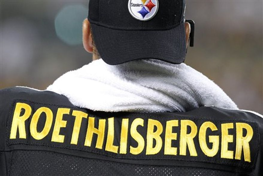 Pittsburgh Steelers injured safety Troy Polamalu stands on the sidelines during the final minute of the Steelers' 27-3 win over the Carolina Panthers in an NFL football game in Pittsburgh, Thursday, Dec. 23, 2010. (AP Photo/Gene J. Puskar)