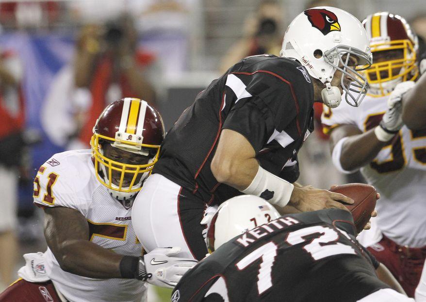 ASSOCIATED PRESS Washington Redskins' Robert Henson, left, sacks Arizona Cardinals quarterback Matt Leinart, top, in the first quarter in a preseason NFL football game Thursday, Sept. 2, 2010, in Glendale, Ariz.