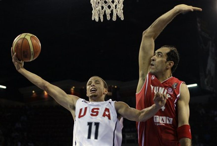 USA's Stephen Curry drives to the basket as Tunisia's Radhouane Slimane guards during their World Basketball Championship preliminary round match in Istanbul, Turkey, Thursday, Sept. 2, 2010. (AP Photo/Ibrahim Usta)
