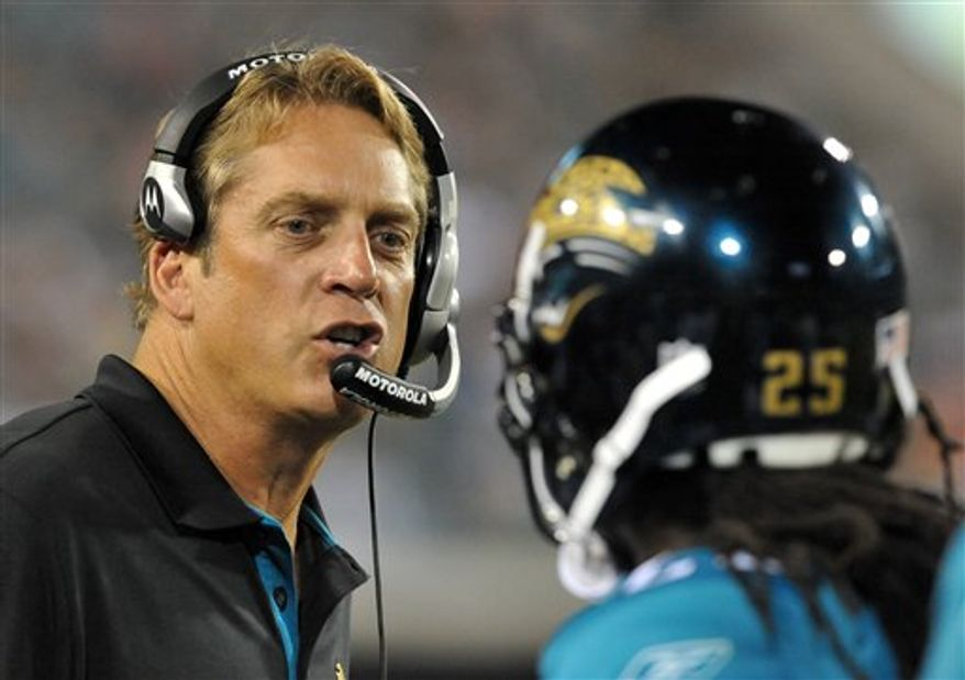 Jacksonville Jaguar head coach Jack Del Rio talks to Reggie Nelson during the first half of a preseason NFL football game Thursday, Sept. 2, 2010 in Jacksonville, Fla. (AP Photo/Stephen Morton)