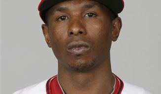 FILE - In this Feb. 28, 2010, file photo, Washington Nationals' Nyjer Morgan poses for a portrait in Viera, Fla. Morgan's wild week has landed him an eight-game suspension, one of nine punishments handed out Friday, Sept. 3, 2010, by Major League Baseball following a brawl between Nationals and Florida Marlins. (AP Photo/Rob Carr, File)