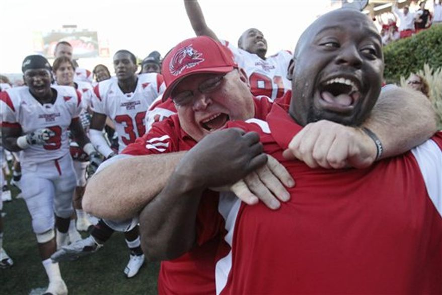 Jacksonville State players celebrate their 49-48 double-overtime victory over Mississippi in an NCAA college football game in Oxford, Miss., Saturday, Sept. 4, 2010. (AP Photo/Rogelio V. Solis)