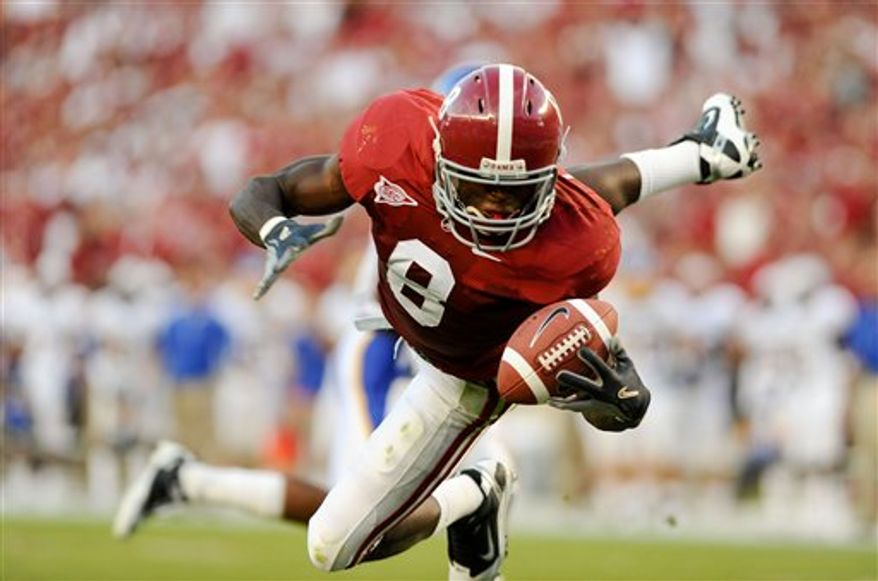 Alabama wide receiver Julio Jones makes a diving one hand grab of a pass for a touchdown during the first half against San Jose State in Tuscaloosa, Ala., Saturday, Sept. 4, 2010.  (AP Photo/The Decatur Daily, Gary Cosby Jr.)