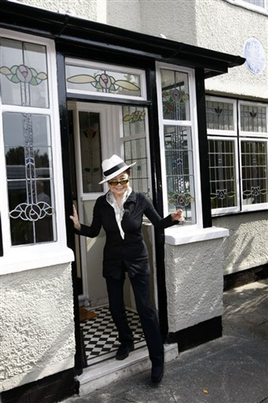 John Lennon's widow Yoko Ono, left, visits his old house in Menlove Avenue, Liverpool, England, Friday, Sept. 3, 2010. (AP Photo/Tim Hales)