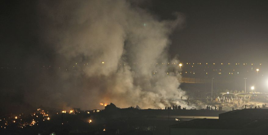 Smoke rises from the crash site of a UPS Boeing 747 cargo plane in Dubai, United Arab Emirates, on Friday, Sept. 3, 2010. (AP Photo/Kamran Jebreili)