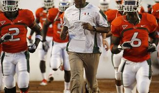 Miami quarterback Jacory Harris looks for an open receiver during the first half of an NCAA college football game against Florida A&M, Thursday, Sept. 2, 2010, in Miami. (AP Photo/Wilfredo Lee)