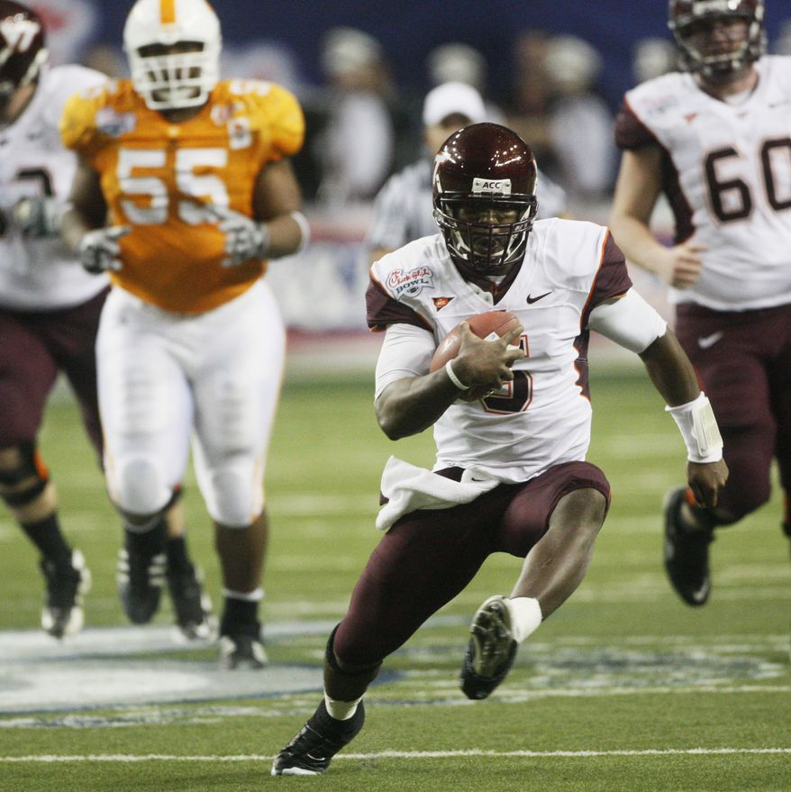 ASSOCIATED PRESS FILE - In this Dec. 31, 2009, file photo, Virginia Tech quarterback Tyrod Taylor scrambles in the second quarter of the NCAA college Chick-fil-A Bowl football game against Tennessee in Atlanta. When Virginia Tech takes the field Monday night against No. 3 Boise State in a huge Week 1 matchup, the No. 10 Hokies' offense will be in a new role.