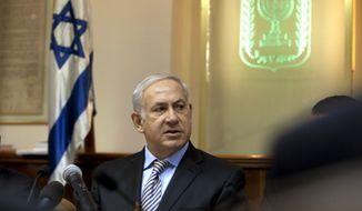 Israeli Prime Minister Benjamin Netanyahu chairs his weekly Cabinet meeting in Jerusalem on Sunday, Sept. 5, 2010. (AP Photo/Menahem Kahana, Pool)