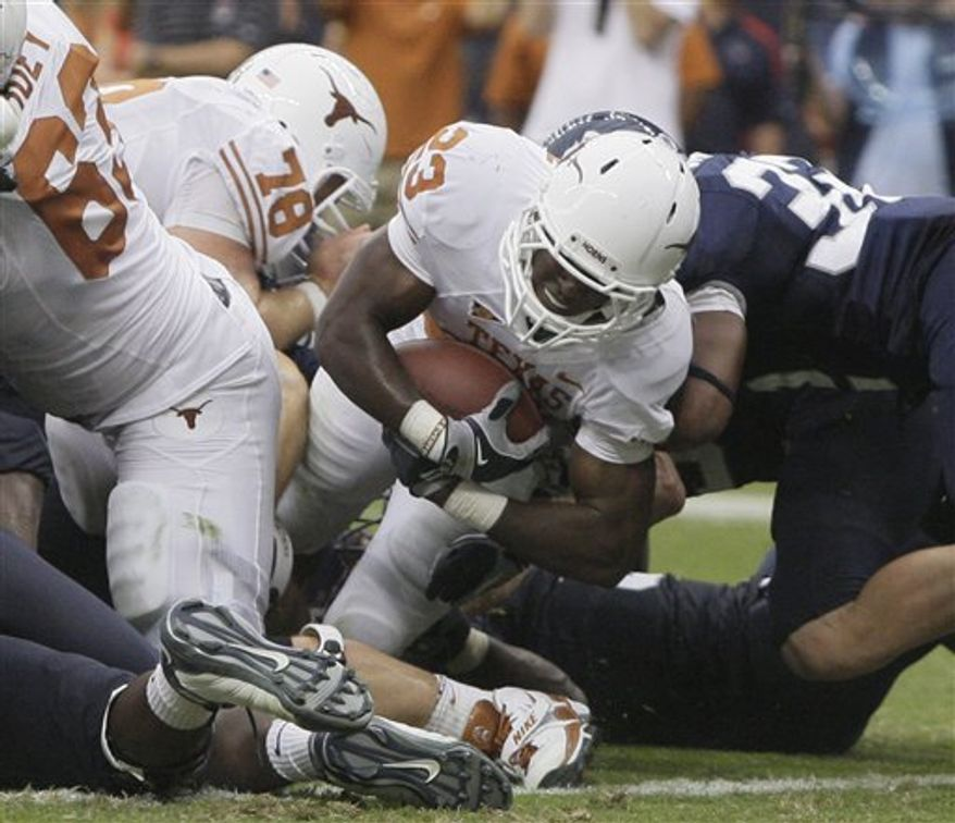 Texas quarterback Garrett Gilbert (7) passes during the second half of an NCAA football game against Rice Saturday, Sept. 4, 2010  in Houston. Texas won 34-17. (AP Photo/Pat Sullivan)