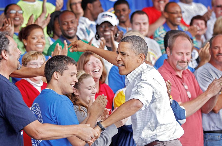 ASSOCIATED PRESS PHOTOGRAPHS AMONG FRIENDS: President Obama greets the crowd at a union-sponsored Labor Day rally in Milwaukee, where he announced his proposal to spend $50 billion on the nation's transportation infrastructure.