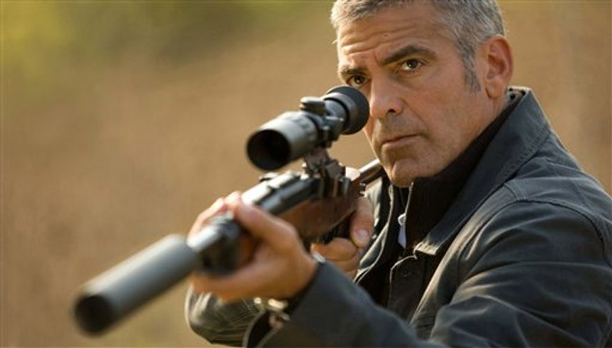 "In this film publicity image released by Focus Features, George Clooney is shown in a scene from, ""The American."" (AP Photo/Focus Features, Giles Keyte)"