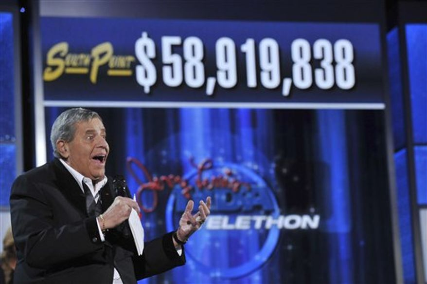 In this photo released by the Muscular Dystrophy Association,  MDA National Chairman Jerry Lewis announces the total mount raised during the the Jerry Lewis MDA Telethon on Monday, Sept. 6, 2010 in Las Vegas.   The Jerry Lewis MDA Telethon say contributions and pledges from this year's Labor Day event totaled $58.9 million.  The amount was down from nearly $60.5 million last year and a record $65 million in 2008. But Lewis says he's heartened by Americans' ability to help others in need even when they're struggling financially.  (AP Photo/Muscular Dystrophy Association, Eric Candles)