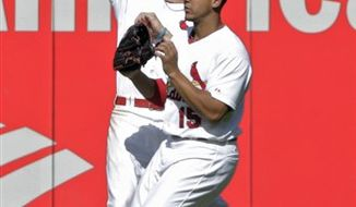 St. Louis Cardinals' Albert Pujols hits an RBI sacrifice fly to score teammate Jon Jay during the first inning of a baseball game against the Cincinnati Reds Friday, Sept. 3, 2010, in St. Louis. (AP Photo/Jeff Roberson)