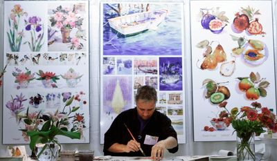 Hallmark Cards Inc. illustrator Craig Lueck works on artwork during a 100-year anniversary reception at the company's headquarters on July 20 in Kansas City, Mo. Hallmark Cards Inc. enters its second century facing a weak economy and what could be an even greater challenge: a generation that has grown up posting its sentiments online. (Associated Press)
