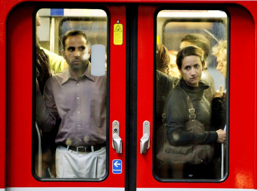 Commuters look through the window of a subway train in Paris. French unions launched a major strike Tuesday over unpopular conservative President Nicolas Sarkozy's plans to raise the retirement age from 60 to 62, with walkouts causing headaches. (Associated Press)